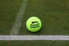 Slazenger Wimbledon Tennis Ball on grass tennis court. NEW YORK - JULY 2, 2019: Slazenger Wimbledon Tennis Ball on grass tennis court. Slazenger Wimbledon Tennis stock photography