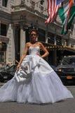 NEW YORK - June 13: Model Kalyn Hemphill crossing the street in front of Plaza hotel Royalty Free Stock Photo