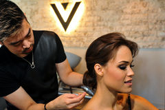 NEW YORK - June 13: Model Kalyn Hemphill getting ready with hair and makeup Stock Photo