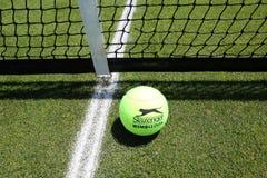 Slazenger Wimbledon Tennis Ball on grass tennis court. NEW YORK - JUNE 26, 2018: Slazenger Wimbledon Tennis Ball on grass tennis court. Slazenger Wimbledon royalty free stock photos