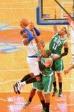 New York Knicks vs Boston Celtics. New York Knicks Carmelo Anthony shooting over Celtic players Stock Image