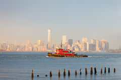 New York Lower Manhattan skyline with a tugboat Stock Photo