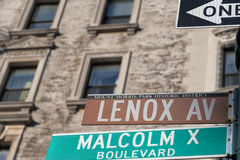 New York Malcom X Boulevard Lenox Avenue street sign Royalty Free Stock Photos