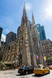 New York, Manhattan. ​NEW YORK - SEPTEMBER 19: View to the St. Patricks Cathedral in Midtown Manhattan with the famous 5th Avenue on SEPTEMBER 19, 2015. Its a Stock Photography
