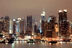New York Manhattan bij Nacht Stock Foto