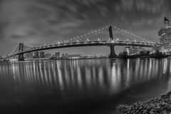 New York manhattan bridge night view from brooklyn in b&w Stock Image