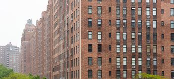 New York, Manhattan Chelsea Area. Brick Wall Facade Skyscrapers Against Cloudy Sky Background Stock Photography