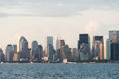 New York Manhattan skyline from bay just before sunset Stock Photo