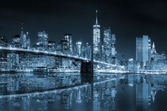 New York - Manhattan Skyline with Brooklin Bridge, blue toned Royalty Free Stock Photos