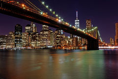 New York. Manhattan Skyline, Brooklyn Bridge and East River at night Royalty Free Stock Images