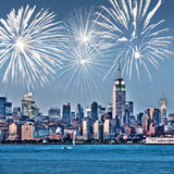 New York Manhattan skyline at night, fireworks in the background, american US celebration and party. New York Manhattan skyline at night, fireworks in the Royalty Free Stock Image