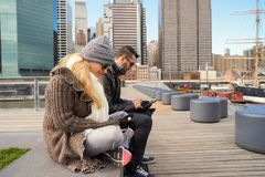 Pier 15. NEW YORK - MARCH 17, 2016: couple at Pier 15 at daytime. Pier 15 is located east of South Street and FDR Drive in Lower Manhattan, New York City Stock Photo