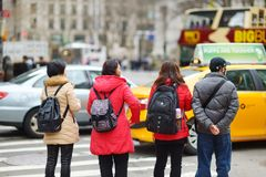 NEW YORK - MARCH 16, 2015: People crossing a street in downtown Manhattan stock photos