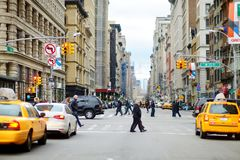 NEW YORK - MARCH 16, 2015: People crossing a street in downtown Manhattan royalty free stock photos
