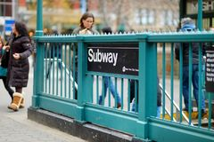 NEW YORK - MARCH 16, 2015: People entering New York subway. royalty free stock photo