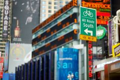 NEW YORK - MARCH 16, 2015: Road sign in New York. Flashing advertisements and lights of downtown Manhattan. royalty free stock photography