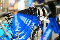 NEW YORK - MARCH 15, 2015: Row of Citi bike rental bicycles at docking station in New York City. Shared bikes lined up in the stre royalty free stock photos