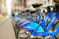 NEW YORK - MARCH 15, 2015: Row of Citi bike rental bicycles at docking station in New York City. Shared bikes lined up in the stre royalty free stock images