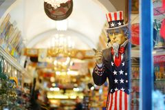 NEW YORK - MARCH 15, 2015: Uncle Sam peeking from souvenir shop in downtown Manhattan, New York, USA.  royalty free stock photos