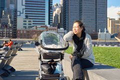 Pier 15. NEW YORK - MARCH 17, 2016: woman take a rest at Pier 15 at daytime. Pier 15 is located east of South Street and FDR Drive in Lower Manhattan, New York Royalty Free Stock Image