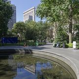 Reflection of the Flatiron Building in the pond. Stock Photos