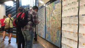 Looking at subway map stock video