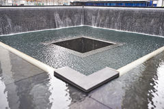 New York 9/11 Memorial at World Trade Center Ground Zero. NEW YORK CITY - MARCH 31: New York 9/11 Memorial at World Trade Center Ground Zero on March 31, 2014 stock images