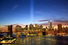 New York in memory of September 11. Manhattan skyline and the Towers of Lights at sunset in New York Stock Images