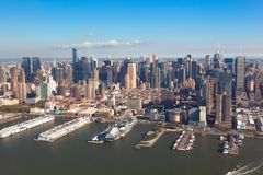 New York Midtown Manhattan in NYC NY in USA. Aerial helicopter view. Pier 84 at Hudson River Park and circle line Sightseeing royalty free stock images