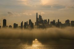 New York Midtown at sunrise covered with dence fog Royalty Free Stock Photo