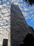 New York mirrors. New York skyscraper with clouds passing through Stock Images
