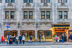 NEW YORK, NEW YORK - DECEMBER 27, 2013: New York Street with Christmas Ligh. The Warwick Hotel Entrance. New York Street with Christmas Ligh. The Warwick Hotel Royalty Free Stock Photos