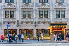 NEW YORK, NEW YORK - DECEMBER 27, 2013: New York Street with Christmas Ligh. The Warwick Hotel Entrance Royalty Free Stock Photos