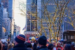 NEW YORK, NEW YORK - DECEMBER 27, 2013: Tourist people in NYC. Christmas Lights in Background. Tourist people in NYC. Christmas Lights in Background royalty free stock photos