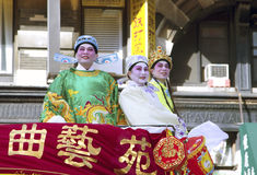 People wearing traditional Chinese costumes Stock Images
