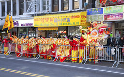 Workers put away Chinese dragon costume Royalty Free Stock Photo