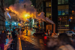 NEW YORK, NEW YORK - JANUARY 10, 2014: New York Street Action with Smoke and People. Royalty Free Stock Image