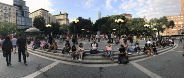 Wide shot of People along Union Square and 14th street NYC. NEW YORK, NEW YORK, USA - AUGUST 25: Panoramic of 14th street and Union Square.  Taken August 25 Royalty Free Stock Photo
