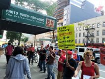 People outside B&H Photo store in Manhattan protesting with signs calling for termination of union-busting in the hands. New York, New York / USA - August 27 stock photography
