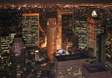 New York at night. Bird's eye view at New York City at night. Skyscrapers and the sea of electric lights Stock Image