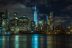 New York by night: Lower Manhattan and the One World Trade Center. (Freedom Tower) in the center of the picture as seen from Brooklyn side stock image