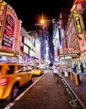 New York Nights. NEW YORK, USA - JUNE 28th 2014: Times Square and 42nd Street is a busy tourist intersection of neon art and commerce and is an iconic street of Stock Photography