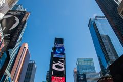 View looking up from Broadway in Times Square Manhattan at skyscrapers with large LCD advertisements royalty free stock photos