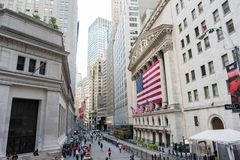 New York Stock Exchange. New York, NY: August 27, 2016: Flag draped NYSE on Wall Street. The New York Stock Exchange NYSE is the largest stock exchange in the Stock Photography