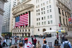 New York Stock Exchange. New York, NY: August 27, 2016: Flag draped NYSE on Wall Street. The New York Stock Exchange NYSE is the largest stock exchange in the Stock Images