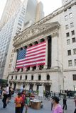 New York Stock Exchange. New York, NY: August 27, 2016: Flag draped NYSE on Wall Street. The New York Stock Exchange NYSE is the largest stock exchange in the Stock Photos