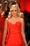 NEW YORK, NY - FEBRUARY 06: Nastia Liukin wearing Reem Acra walks the runway at The Heart Truth's Red Dress Collection during Fall. 2013 Mercedes-Benz Fashion royalty free stock photo