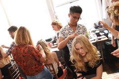 Free NEW YORK, NY - June 16: A Hair Stylist Getting Model Ready Backstage Stock Images - 41822264