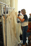 NEW YORK, NY - June 16: Designer Claire Pettibone getting dresses ready backstage Stock Image