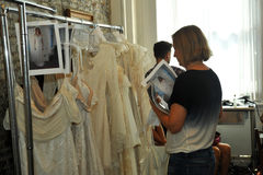 NEW YORK, NY - June 16: Designer Claire Pettibone getting dresses ready backstage Royalty Free Stock Images